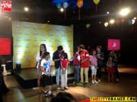 the Media with their kid companion at the Jollibee Christmas Party