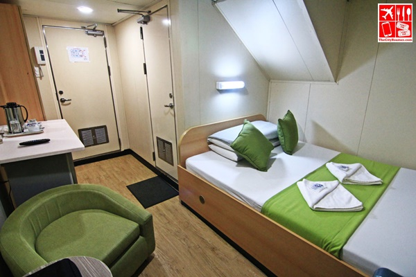 2Go Travel's M/V Saint Ignatius of Loyola's stateroom with double bed and T&B