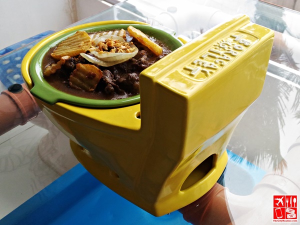 Meat dish served in toilet bowl at Boracay Toilet