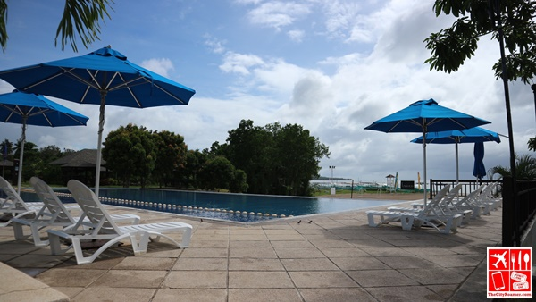 Soak in the sun by the pool with reclining chairs and umbrella