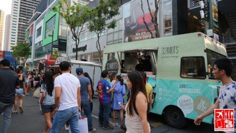 Foodies enjoy the food trucks along 9th Street of Bonifacio High Street
