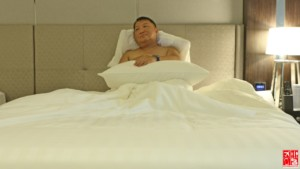 enjoying the comfy bed in my Le Charme Suites room