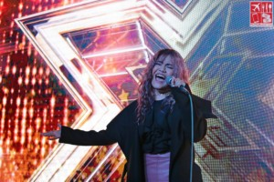 A grown-up Maria Laroco performs during her homecoming event