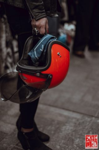 A motorcycle helmet held by hand /Photo by Clem Onojeghuo on Unsplash