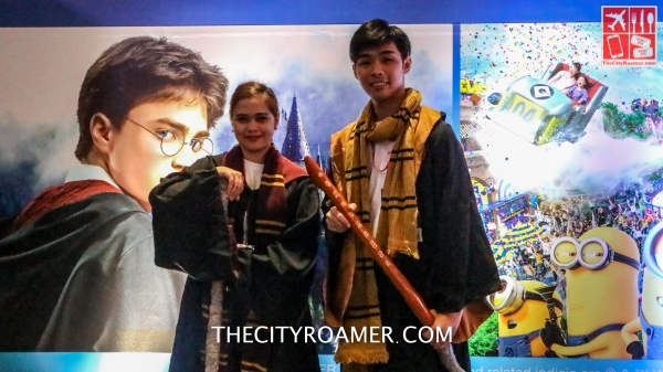 Harry Potter-clad costumes worn by these Universal Studios duo manning the booth